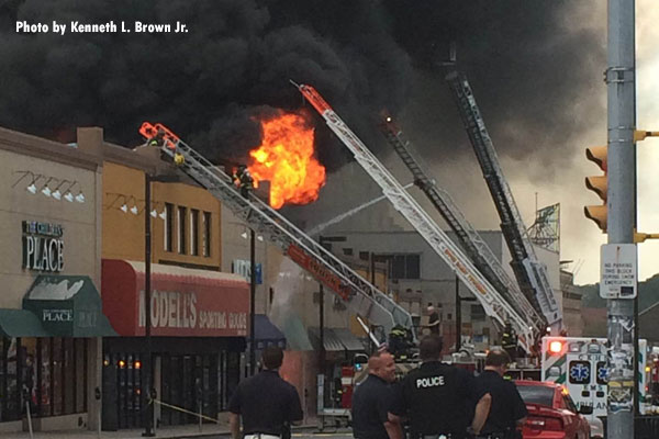 Firefighters conduct aerial operations at a 4-alarm fire in Upper Darby Township, Pennsylvania.
