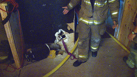 (5) We anchored the hose with a clove hitch. Not pictured is the girth hitch on a halligan tool on the other side of the wall.