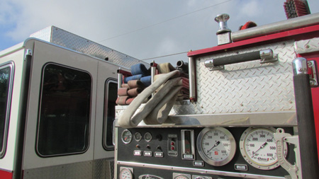 This is the finished flat load with strategically placed loops. Note that the backup loop is under the nozzle firefighter loop and the location of the nozzle.