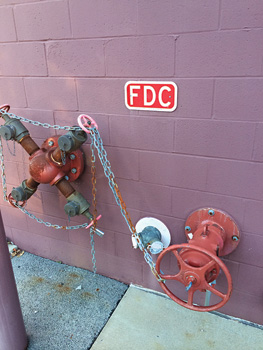 (3) This is a common exterior connection setup. It includes a fire pump test header with four male-threaded 2½-inch connections, a typical double 2½-inch female-threaded FDC, and a control valve.