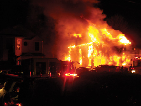 (1) Rapid interior and exterior fire spread will force us to change house fire tactics. This fire went from a mulch fire to fully involved in less than five minutes. (Photos by author.)