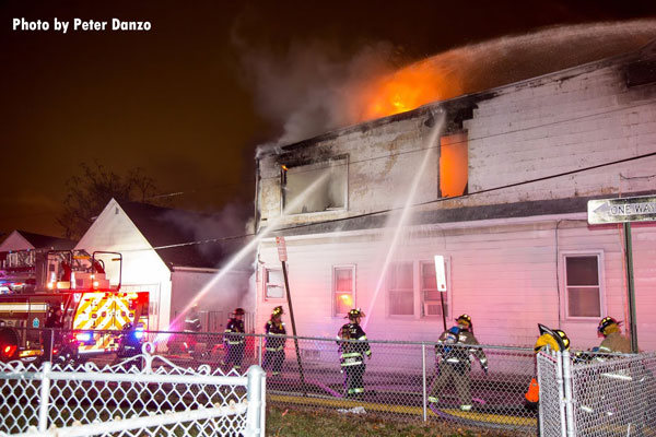 Firefighters use two handlines on the exterior of a dwelling fire in Belleville, New Jersey.