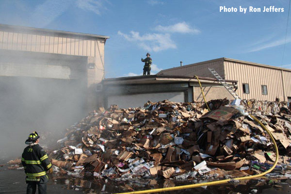 Firefighters at the scene of a multi-alarm recycling center fire in Lyndhurst, New Jersey.