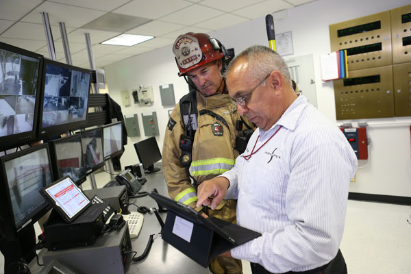Firefighters manage intelligence at the scene of an incident.