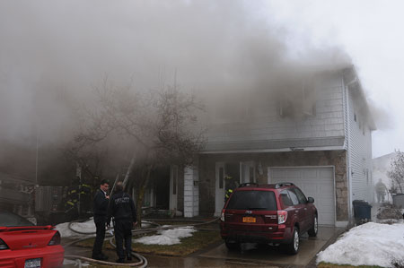 (1) The fire was in a two-story semiattached private dwelling; it started on the first floor. <i>(Photos by Steve White.)</i>