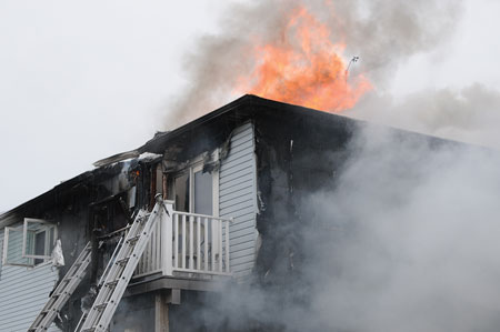 (4) Fire in the attic space intensified rapidly; two additional ladders were placed to windows on the second floor. It is vital to communicate the location of these ladders to members on the interior of the fire building.