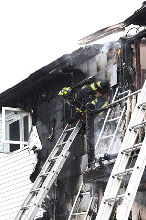 (5) A member operating on the interior of the fire building was trapped by the intensifying fire and collapse of the top-floor ceiling. He made his way to a window and prepared for a head-first ladder slide.