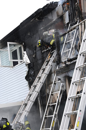 (6) The firefighter exited the window head first to stay low in the window below the heat and fire.