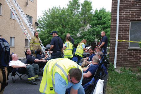 (3) Firefighters undergo rehab at an extra-alarm apartment fire. <i>(Photo by Diane M. Zaccard.)</i>