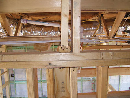 (4) Finger joint trusses. There is less mass, less connection integrity, and more glue. (Photo by John Mittendorf.)