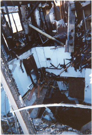 (6) The roof failed at this lightweight truss structure and caused the failure of the floors below in an impact-load collapse.