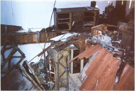 (7) Unburned trusses that were ripped from the truss loft as the roof and floors above collapsed on top of them.