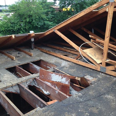 (1) Compare the original flat roof joists and the lightweight renovated peaked wood roof trusses. Which would you rather work on?<i> (Ph</i>otos by author unless otherwise noted.)
