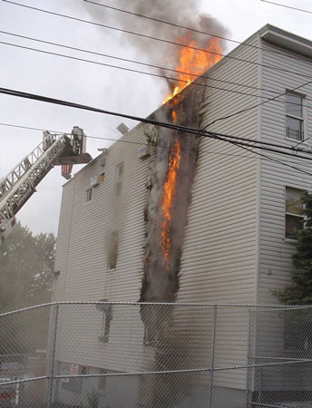 """(1) """"V"""" pattern forming on the outside of a building. It produces an arrow that points to the room where the fire started. <i>(</i>Photos by author unless otherwise noted.)"""