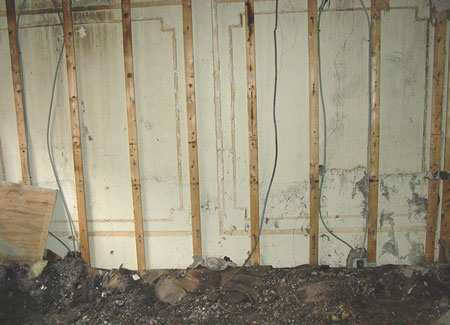 (10) In this fire, each of the four walls and the ceiling were pulled entirely. Yet, as can be seen here, the wall furring strips are undamaged; hence, it was unnecessary to demolish the wall. If this were a case of arson, a key indicator of the fire's location would be lost.