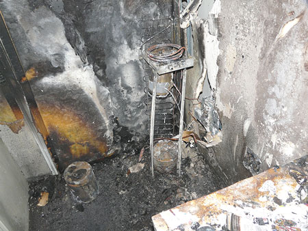 (11) This fire occurred in a high school office. Burn pattern analysis placed the fire in the corner where a water cooler was located. It was eventually determined that a faulty relay on the hot water tank caused the unit to overheat and cause the fire.