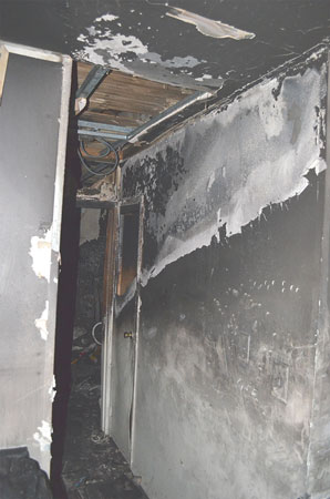 (3) A descending heat pattern on a gypsum board wall leading to the room of fire origin.