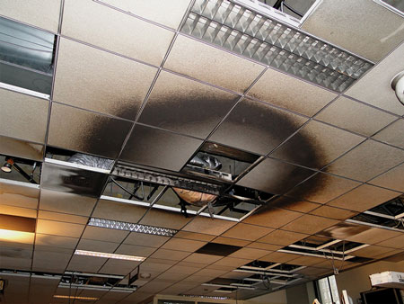 (7) A circular pattern on ceiling tiles directly above where a fire originated.