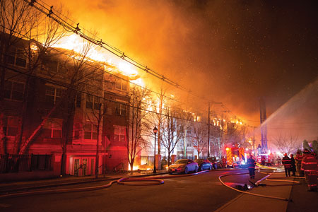 """(1) Despite the fact that this complex was broken down into six buildings through the use of fire walls, the fire area still encompassed an entire city block along Undercliff Avenue. <i>(Photos 1-5 by Michael Coppola.) </i>""""></td> </tr> <tr> <td align="""