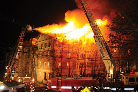(8) The corner of Russell and Undercliff Avenues. Fire is spreading down Russell Avenue toward the east.