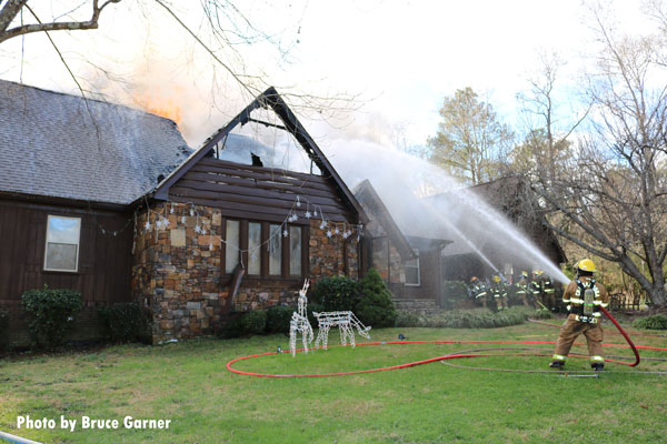 Firefighters use exterior hoselines on a fire in the Big Ridge community of Chattanooga.
