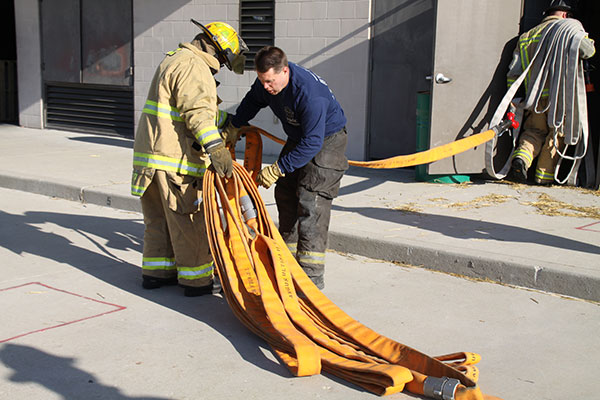 Firefighters praticiing flaking out hoselines during training evolutions.