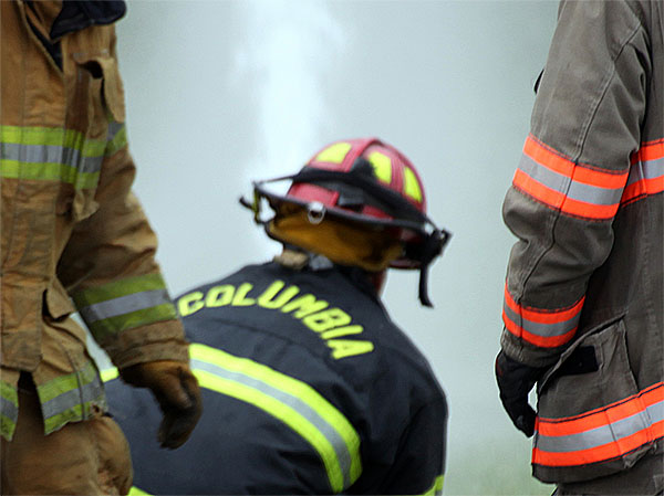 A firefighter controls a hoseline during training.