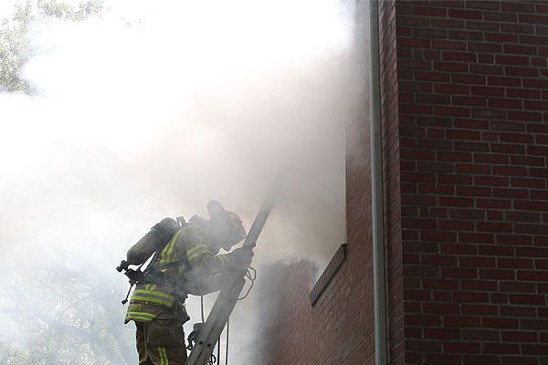 A firefighter on a ladder.