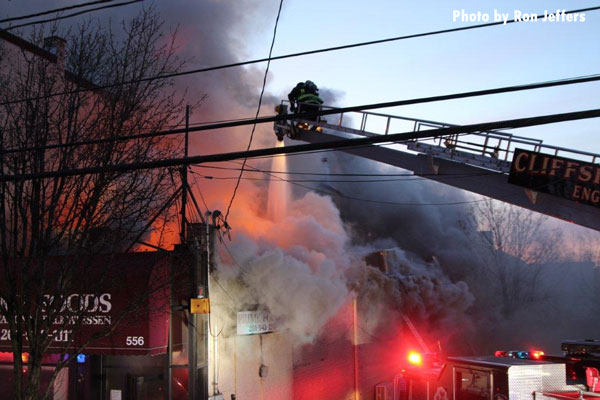 Firefighters pour water on a fire in Cliffside Park, New Jersey.