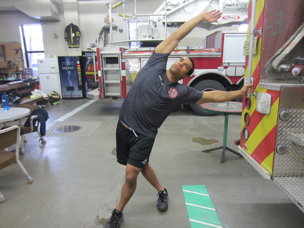 Jordan Ponder performs a stretch on the rig to alleviate low back pain.