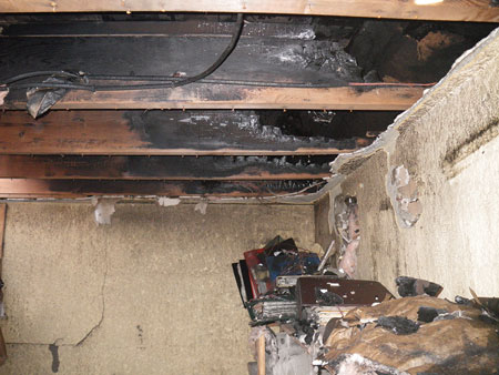 (3) Burn patterns in a flat roof joist space after a three-story apartment fire. Dimensional lumber used in flat roof construction is common to modern and older buildings.