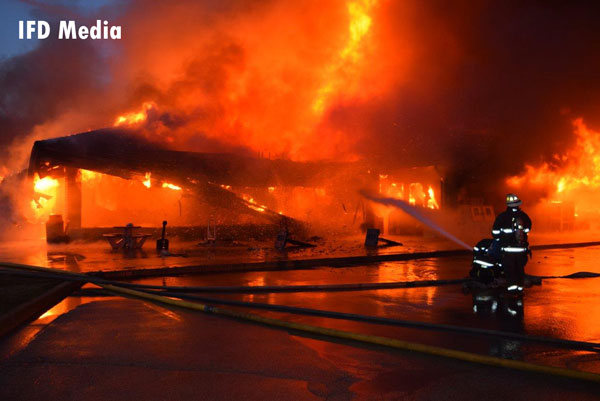 Indianapolis firefighters battle flames at at truck stop.