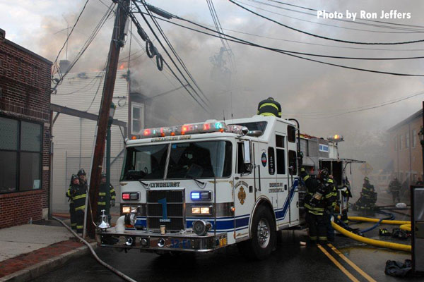 Fire apparatus and firefighters at the scene of a fire in Lyndurst, New Jersey.