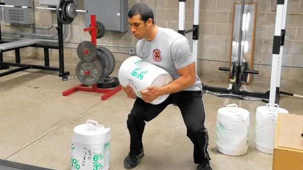 Jordan Ponder performing firefighter physical fitness training