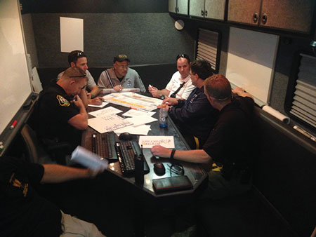 (1) The Hostile Threat branch CP inside the command bus. <i>(Photo by Daniel J. Neal.)</i>