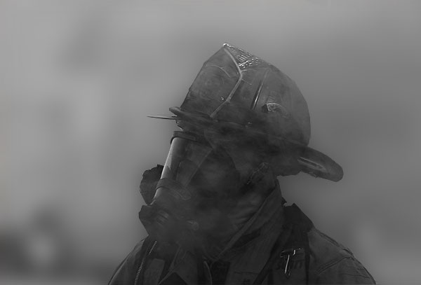 Silhouette of a firefighter