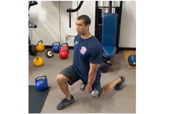 Jordan Ponder performing firefighter-specific exercises.
