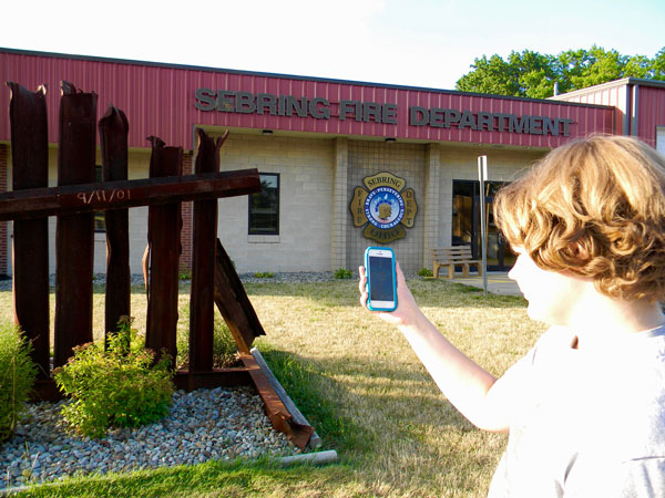 A teen plays Pokemon Go outside the Sebring Fire Department.