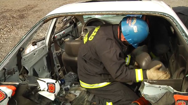 Removing the front seat to access the patient.