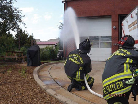 (2) Personnel apply water with a fog nozzle set to a narrow fog for 10 seconds and move the nozzle in a smooth, controlled motion. This is being pumped through a 200-foot, 1½-inch attack line with a 125-gpm, 75-psi fog nozzle.