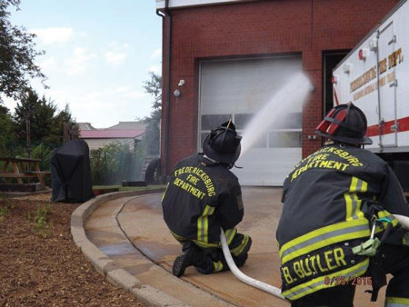 (3) Personnel apply water with a fog nozzle set to a narrow fog for 10 seconds and move the nozzle in a smooth, controlled motion. This is being pumped through a 200-foot, 1½-inch attack line with a 125-gpm, 75-psi fog nozzle.