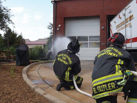 (4) Personnel apply water with a fog nozzle set to a narrow fog for 10 seconds and move the nozzle in a smooth, controlled motion. This is being pumped through a 200-foot, 1½-inch attack line with a 125-gpm, 75-psi fog nozzle.