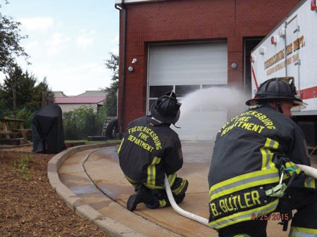 (5) Personnel apply water with a fog nozzle set to a narrow fog for 10 seconds and move the nozzle in a smooth, controlled motion. This is being pumped through a 200-foot, 1½-inch attack line with a 125-gpm, 75-psi fog nozzle.