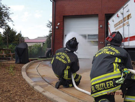 (6) Personnel apply water with a fog nozzle set to a narrow fog for 10 seconds and move the nozzle in a smooth, controlled motion. This is being pumped through a 200-foot, 1½-inch attack line with a 125-gpm, 75-psi fog nozzle.