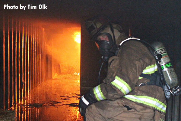 A firefighter undertakes training at the Monroe Fire School.