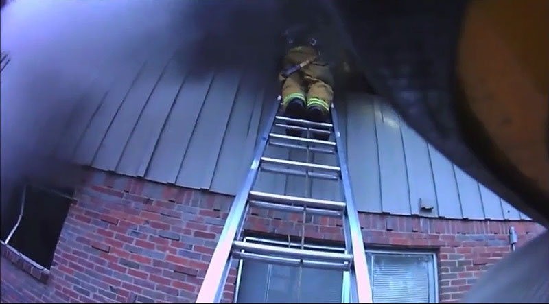 Firefighters performing a VES operation.