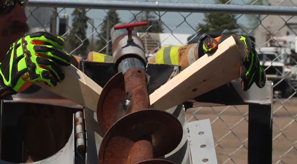Firefighters use chocks to stabilize the auger.