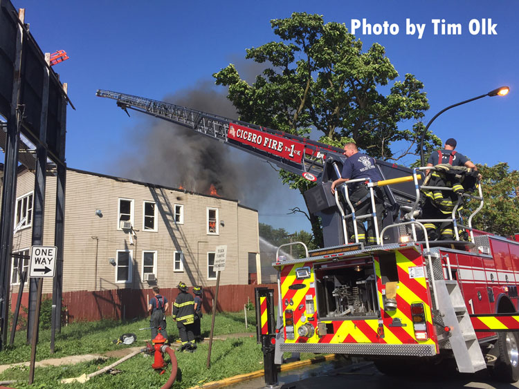 Firefighter use an aerial device at the scene of a fire in Cicero, Illiinois.
