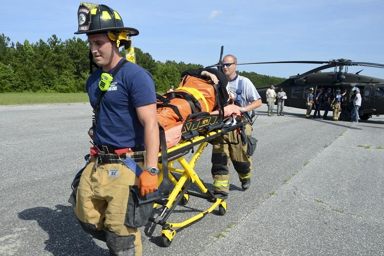 Rescuers remove a victim.