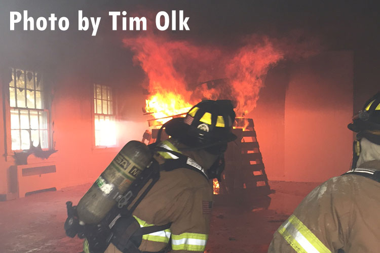 Firefighters undertake live-fire training in an acquired structure.